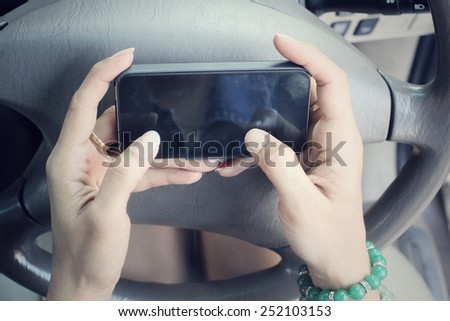 Woman using smart phone in the car. - stock photo