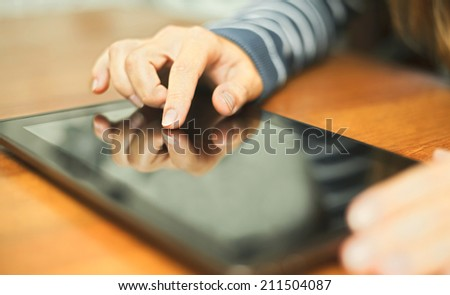 Woman using tablet pc - stock photo