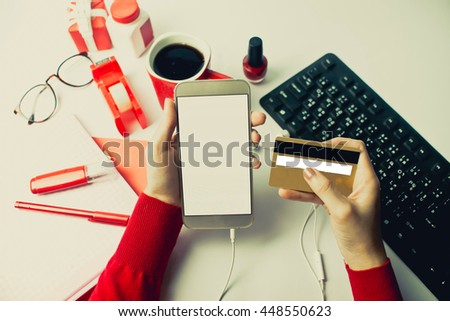 Woman verifies account balance on smartphone with mobile banking application.vintage color - stock photo