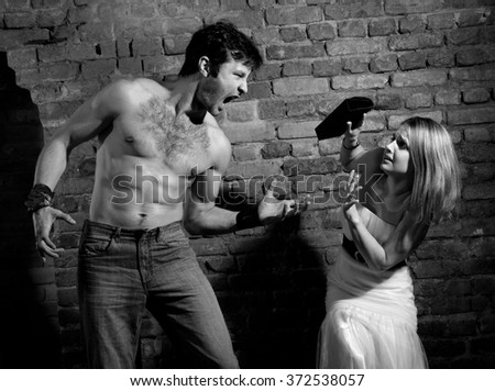 Woman victim of domestic violence. Aggression in the family.Family fights.Family hatred.Heavy men and women.Black and white image - stock photo
