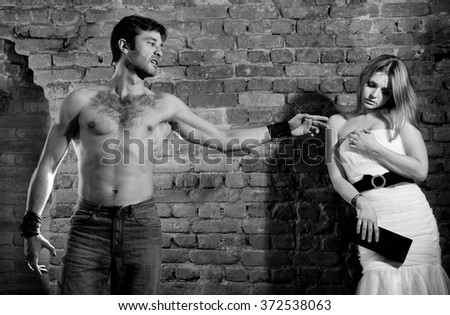 Woman victim of domestic violence. Aggression in the family.Family fights.Family hatred.Heavy men and women. Black and white image - stock photo