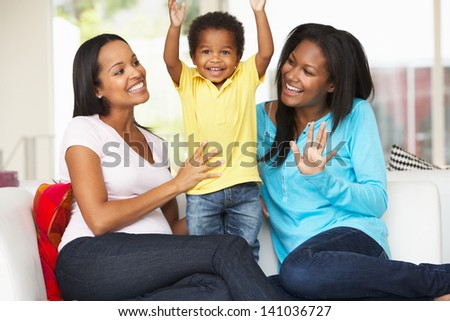 Woman Visiting Pregnant Friend With Son At Home - stock photo