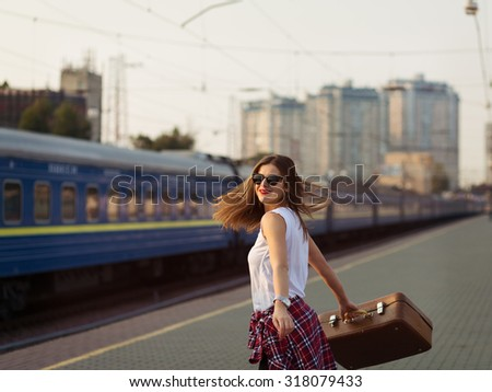 Woman waiting for a train. Retro toned image - stock photo
