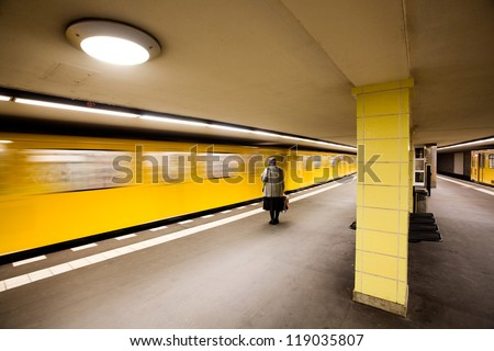 Woman waiting for subway, Berlin - stock photo