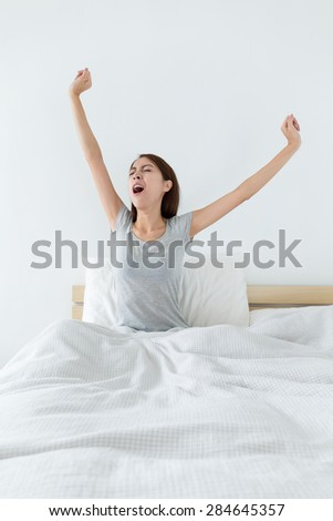 Woman wake up at morning and hand stretching - stock photo