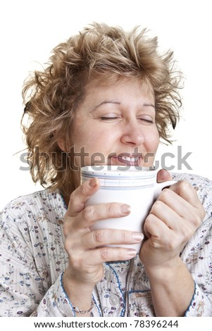 Woman waking up with a coffee - stock photo