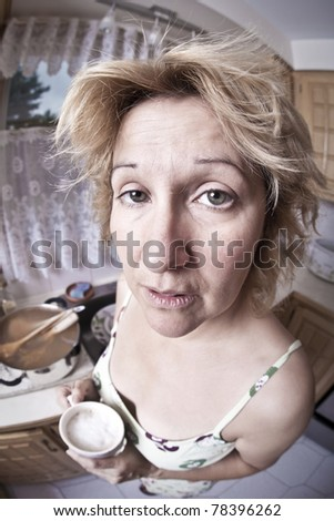 Woman waking up with a coffee (Dirty dishes fisheye) - stock photo