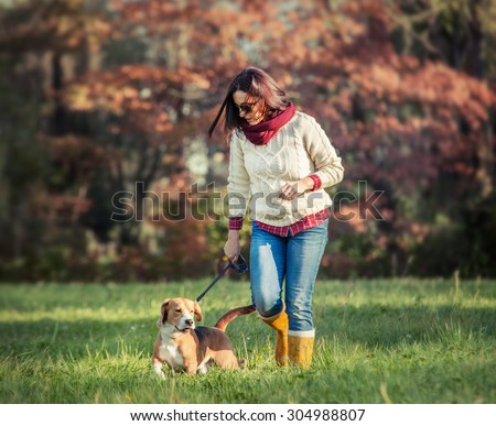 Woman walk with dog - stock photo