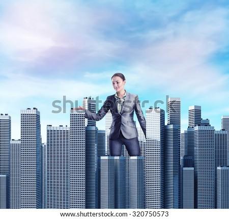 Woman walking among skyscrapers - stock photo