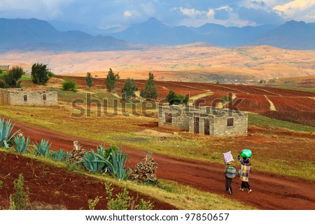 Woman walking in the streets of a village in Africa - stock photo
