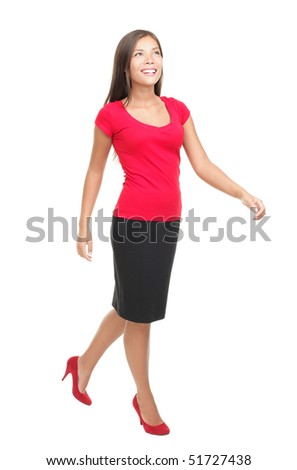 Woman walking isolated on white. Full body image of a beautiful mixed Chinese Asian / Caucasian young woman model in her twenties. - stock photo