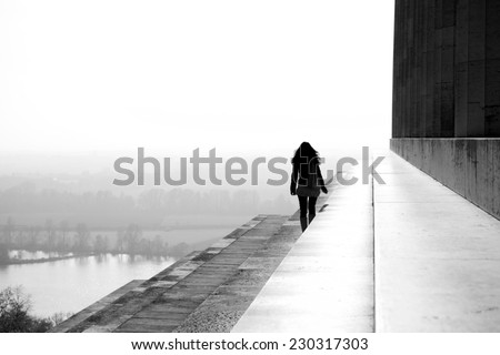 Woman walking on a roof of the world - stock photo
