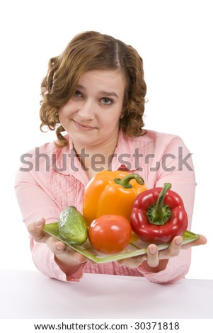 Woman wants to eat fresh vegetables. Housewife is holding the plate with pepper, tomato, cucumber. Pretty girl with fresh vegetables. Isolated over white background. - stock photo