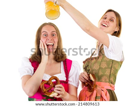 Woman wants to shower afraid girl with beer - stock photo