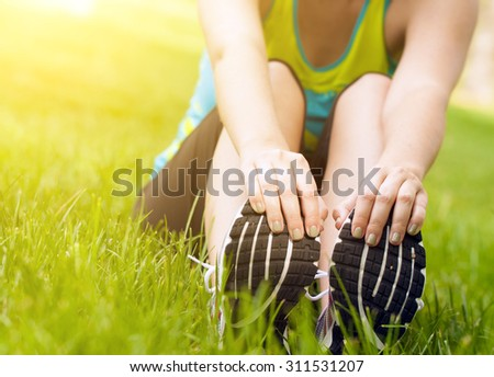 Woman warming up - stock photo