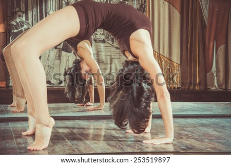 Woman warming up before dance classes - stock photo