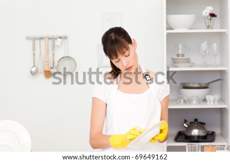 Woman washing dishes in the kitchen - stock photo