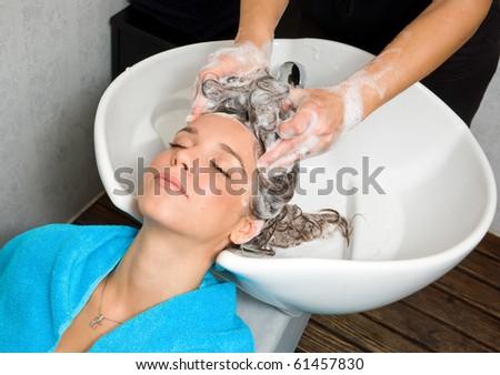 woman washing hair in salon pool - stock photo