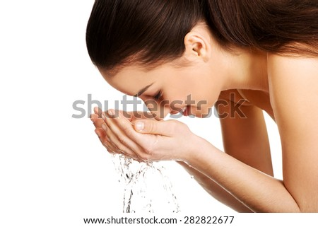 Woman washing her clean face with water. - stock photo