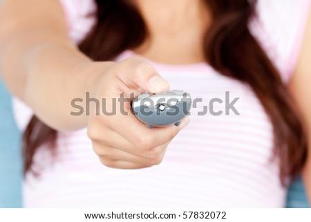 Woman watching TV on sofa - stock photo