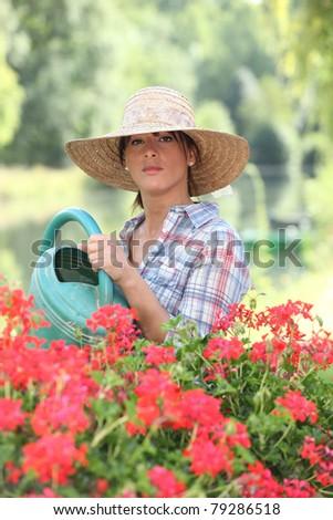 Woman watering flowers - stock photo