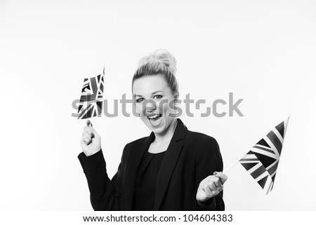 woman waving a british flag about in the air - stock photo