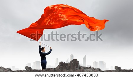 Woman waving red flag - stock photo