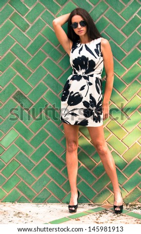 Woman wearing a black and white print dress - stock photo