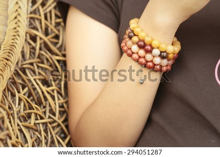 Woman wearing a black shirt and bracelet jewelry. - stock photo