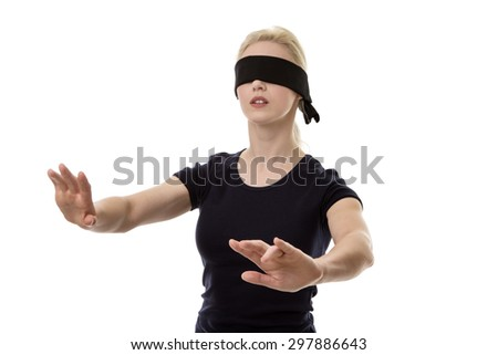 woman wearing a blindfold not sure what to do - stock photo