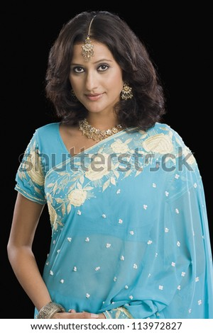 Woman wearing a sari and smiling - stock photo