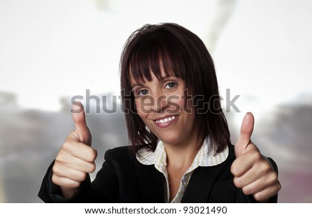 woman wearing a suit with her thumb's up - stock photo