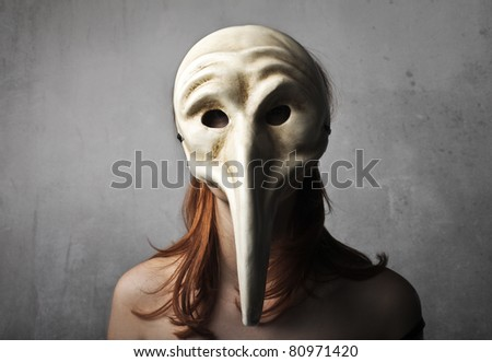 Woman wearing a vintage mask - stock photo