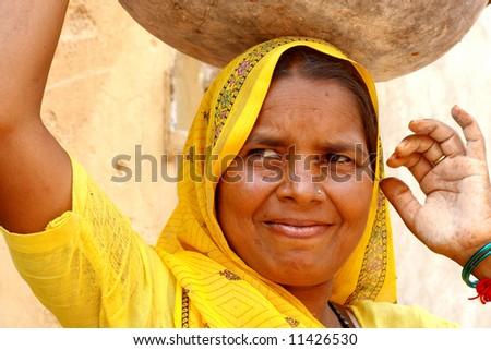 Woman wearing a yellow sari - stock photo