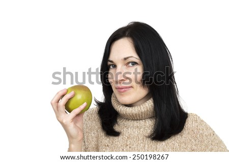woman wearing beige sweater holding apple isolated over white  - stock photo