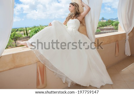 woman wearing bride or graduation dress  - stock photo