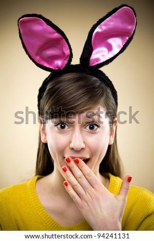 Woman wearing bunny ears - stock photo