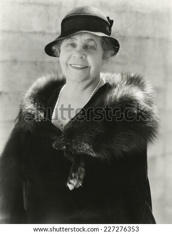 Woman wearing fur stole - stock photo
