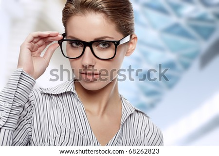 Woman Wearing Glasses in office background - stock photo