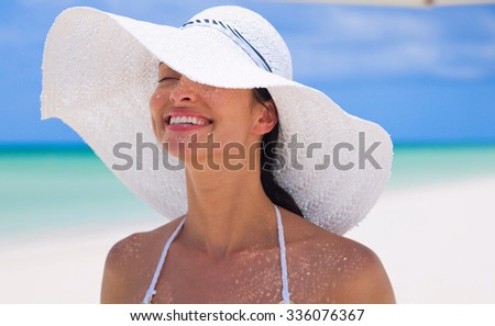 woman wearing hat in summer - stock photo