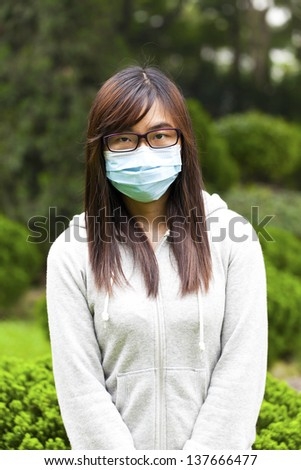 Woman wearing medical face mask - stock photo