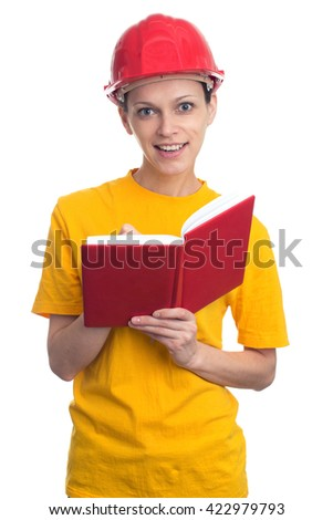 Woman wearing protect helmet and making notes in a notebook - stock photo