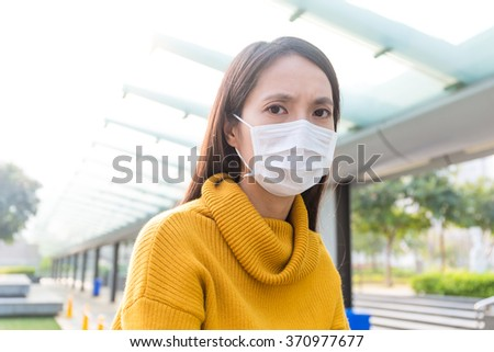 Woman wearing protective mask - stock photo