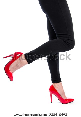 Woman wearing red high heel shoes, isolated on white - stock photo