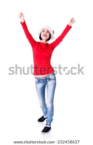 Woman wearing santa clothes in a winner gesture. - stock photo