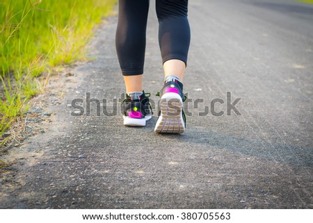 woman wearing sports shoes, walkings or running - stock photo