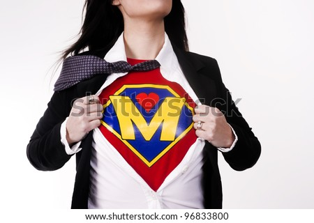 Woman wears a superhero style t-shirt under her business suit Modern Mom Mother Super Parent Character - stock photo