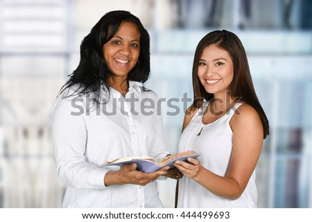 Woman who is happy to be studying the Bible - stock photo