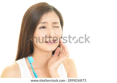 Woman who is worried about the tooth decay - stock photo