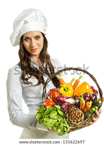 Woman with a basket full of vegetables - stock photo